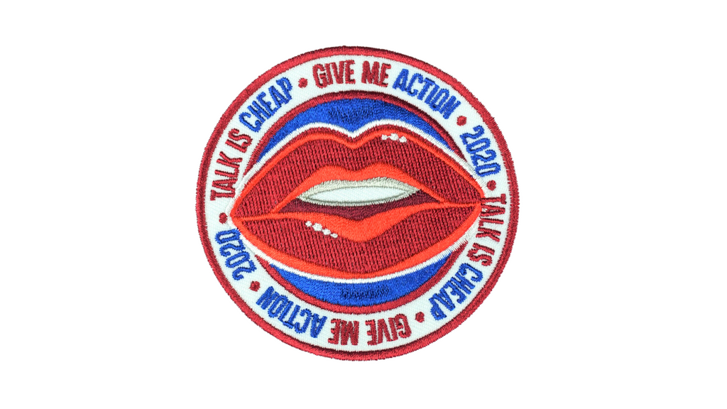 "3"" embroidered circle shape sew-on patch in red, white blue. Red lips in center of patch, with text around the edge reading Give Me Action, Talk is Cheap, 2020"