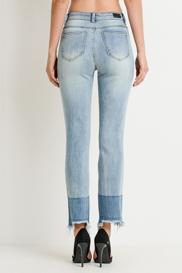High Rise Light Wash Dipped Dye Hem Distressed Jeans