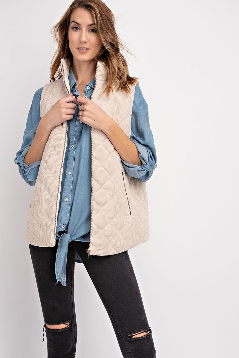 Woman wearing an oatmeal corduroy vest with pockets