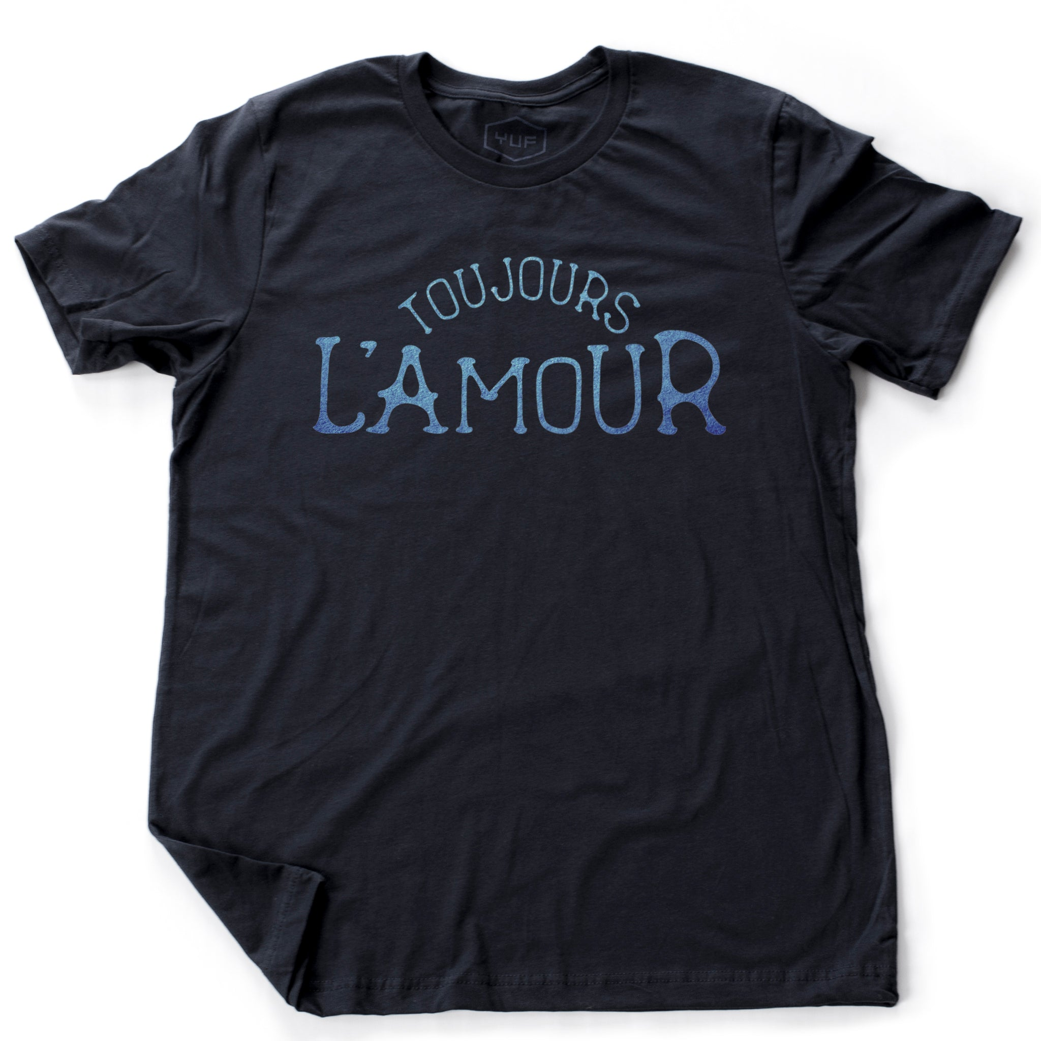 "A unisex fashion t-shirt in Classic Navy Blue with the retro, vintage-inspired typographic statement ""TOUJOURS L'AMOUR,"" French for ""love always."" By fashion brand YUF, from Wolfsaint.net"