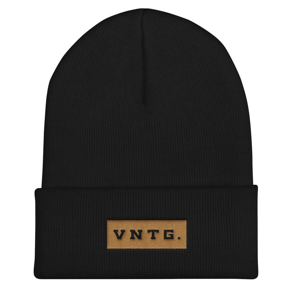 A stylish knit cap or beanie in classic Black, with the brand logo VNTG. embroidered in gold thread. From wolfsaint.net