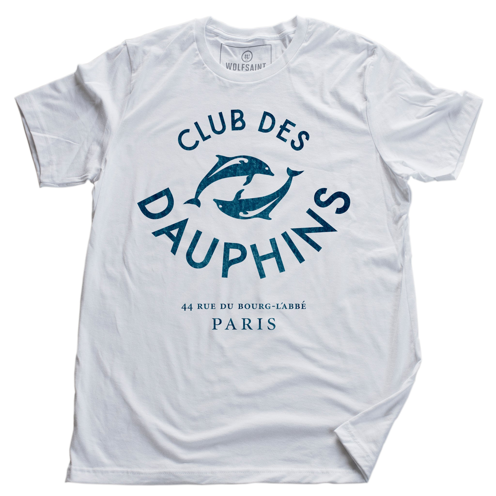 "A vintage-inspired fashion t-shirt featuring a retro graphic of two dolphins, surrounded by the words ""CLUB DES DAUPHINS,"" or Dolphin Club in French, a fictitious club in Paris, France. By fashion brand Wolfsaint. From Wolfsaint.net"