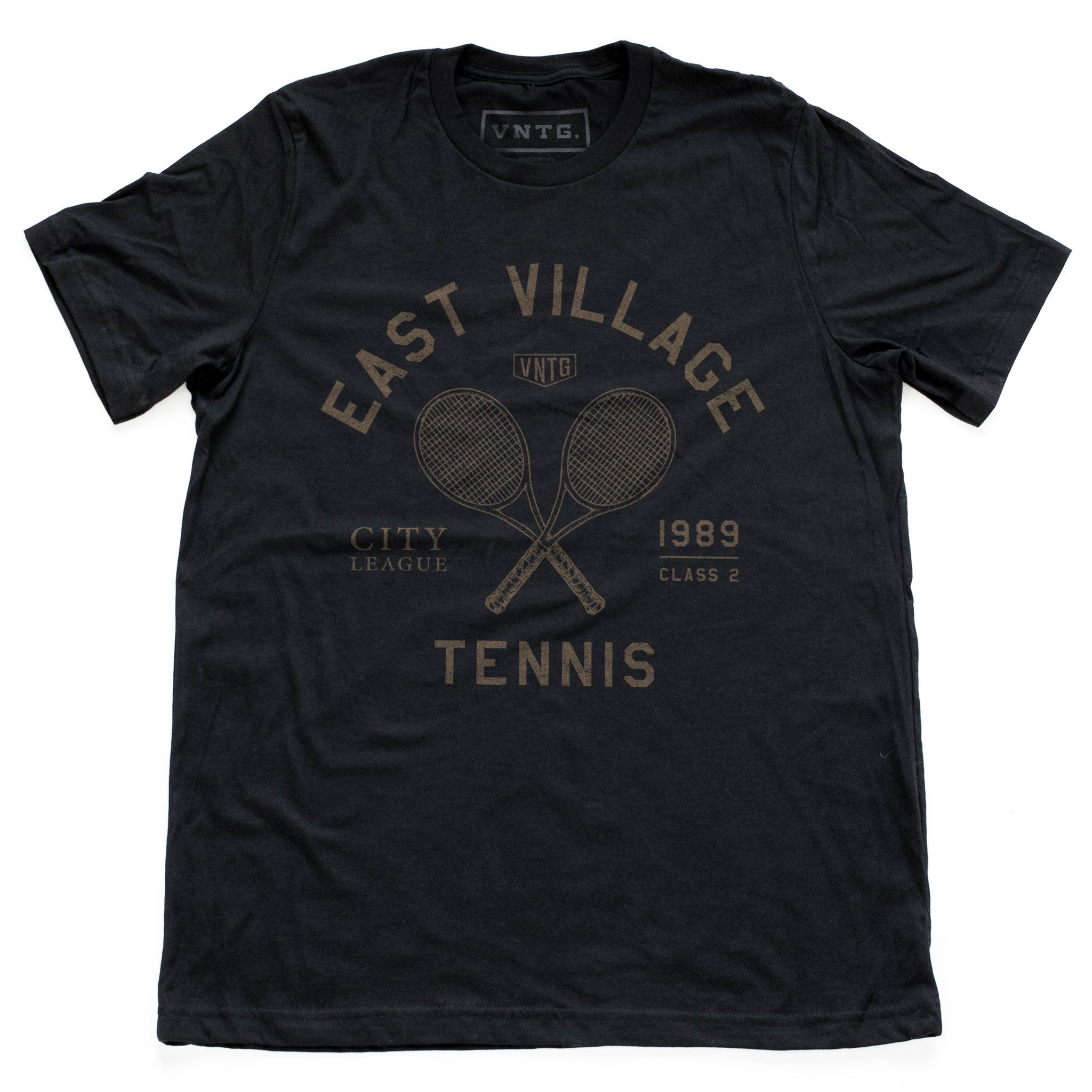 "Retro, vintage-inspired graphic t-shirt for a fictional East Village (New York City) city tennis league, featuring a graphic of a crossed set of tennis racquets and the words ""East Village"" in an arc above. By fashion brand VNTG., from www.wolfsaint.net"