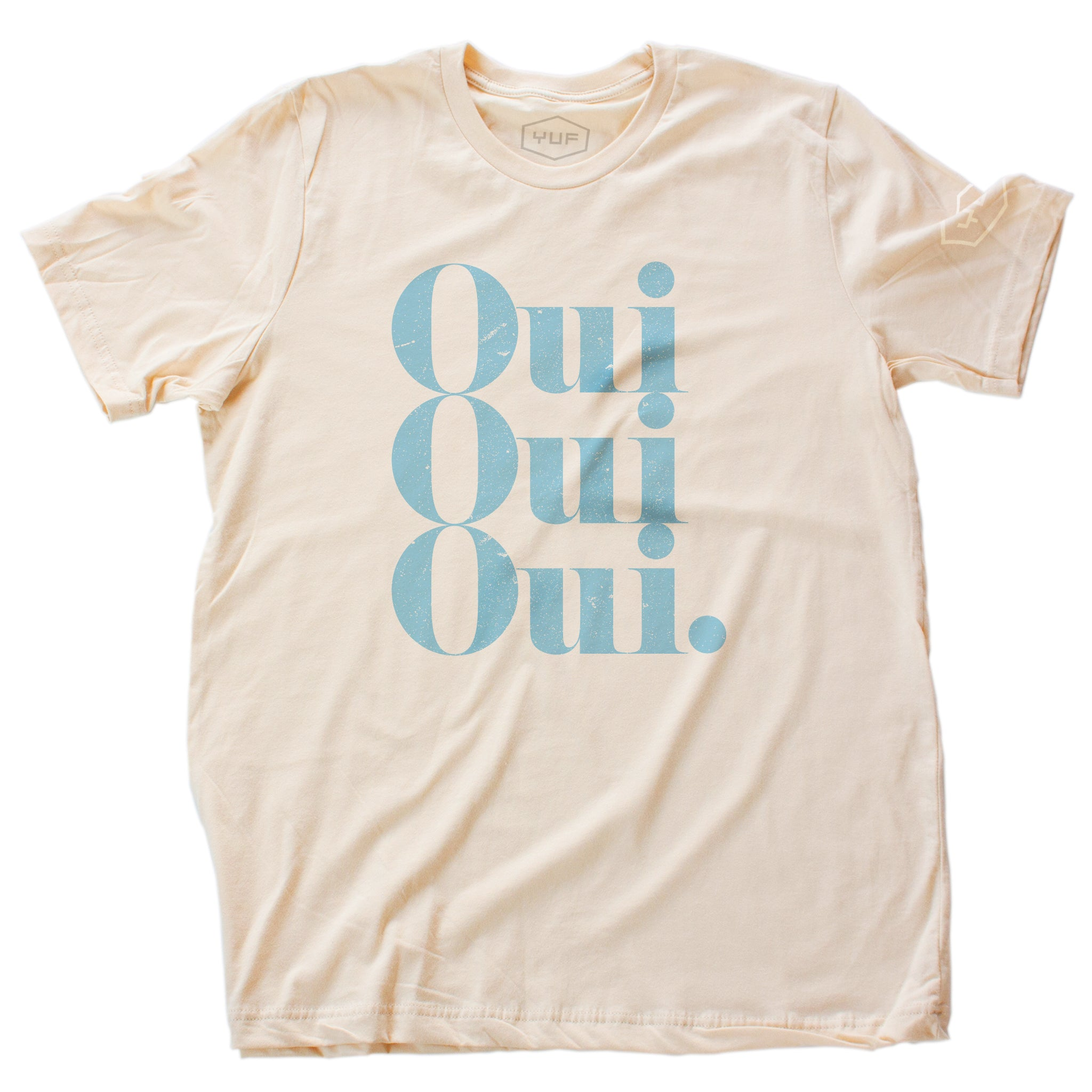 "A stylish retro graphic t-shirt with a vintage typographic treatment repeating the French word ""Oui"" (Yes) three times. In robin's egg blue on Soft Cream, by fashion brand YUF, from wolfsaint.net"