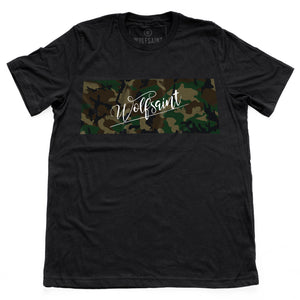 "The front of a fashionable black t-shirt with a camo / camouflage panel on both sides. On the front there is also a Wolfsaint script logo within the camo panel; on the reverse are the Wolfsaint cities ""New York, Rio de Janeiro, Los Angeles"" listed innsmaller type below the camouflage. From Wolfsaint.net"