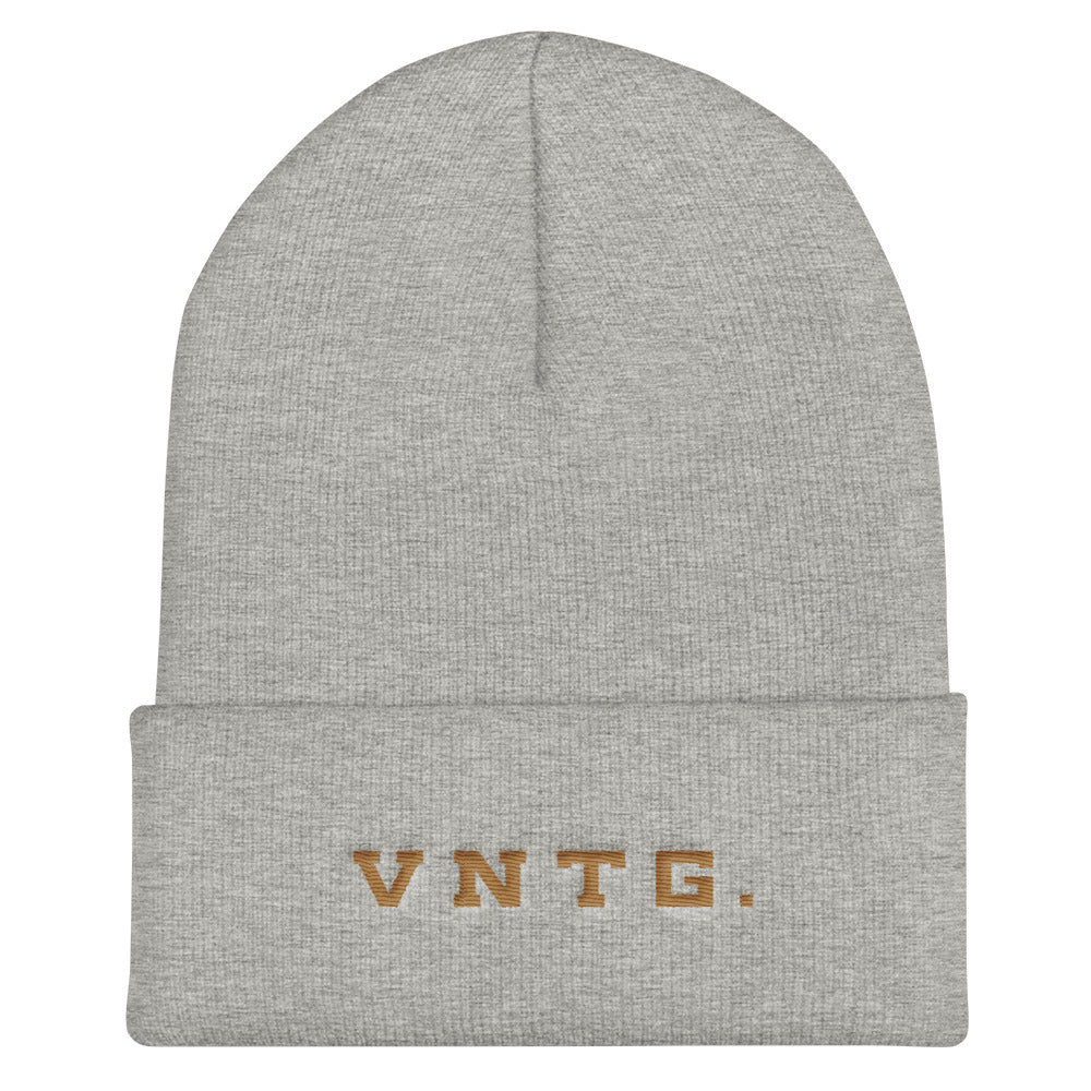A stylish knit cap or beanie in classic light gray, with the brand logo VNTG. embroidered in gold thread. From wolfsaint.net