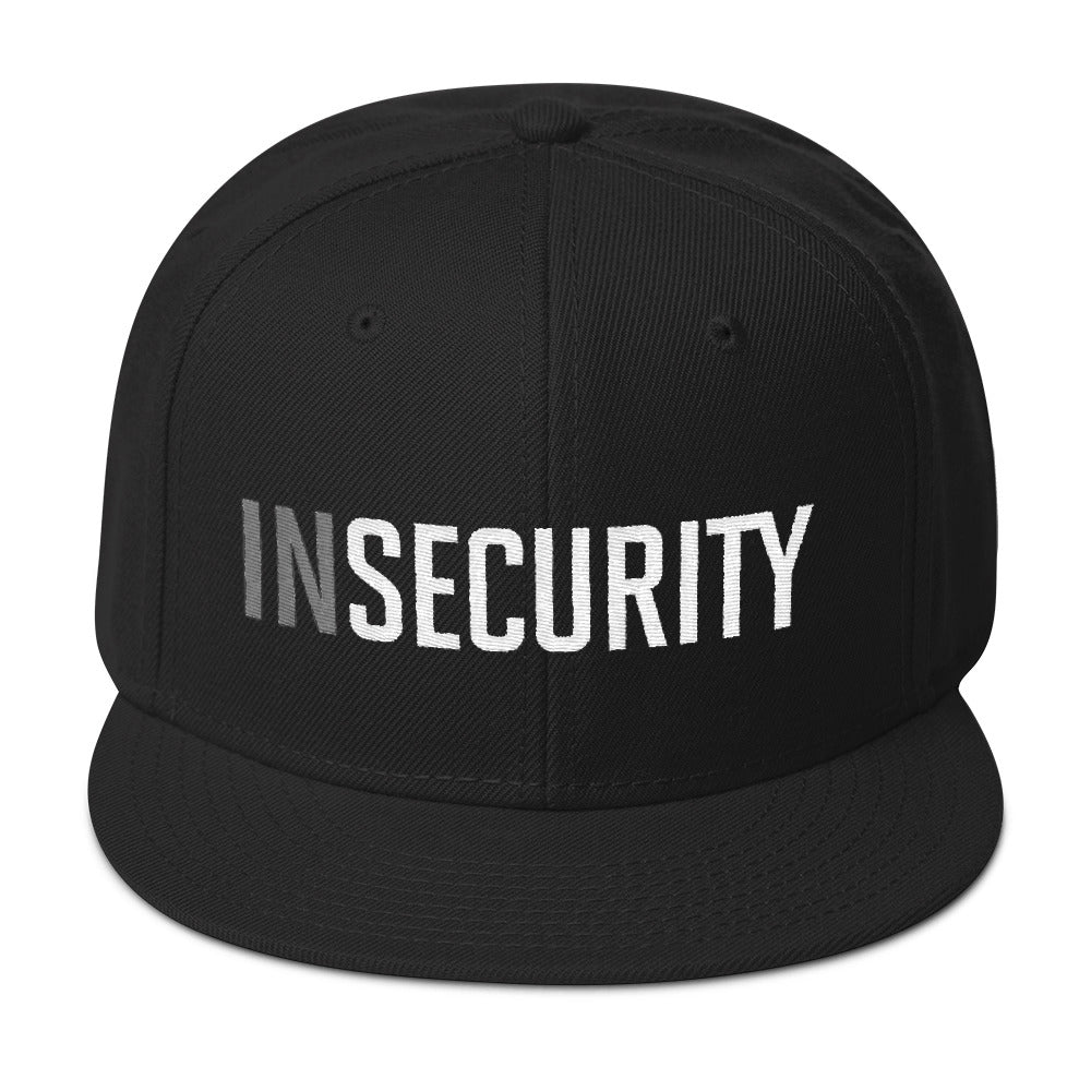 A classic black SnapBack cap with the sarcastic typographic play on words. It reads INSECURITY, instead of SECURITY, as an ironic, self-deprecating meme style visual pun. By fashion brand YUF, from wolfsaint.net