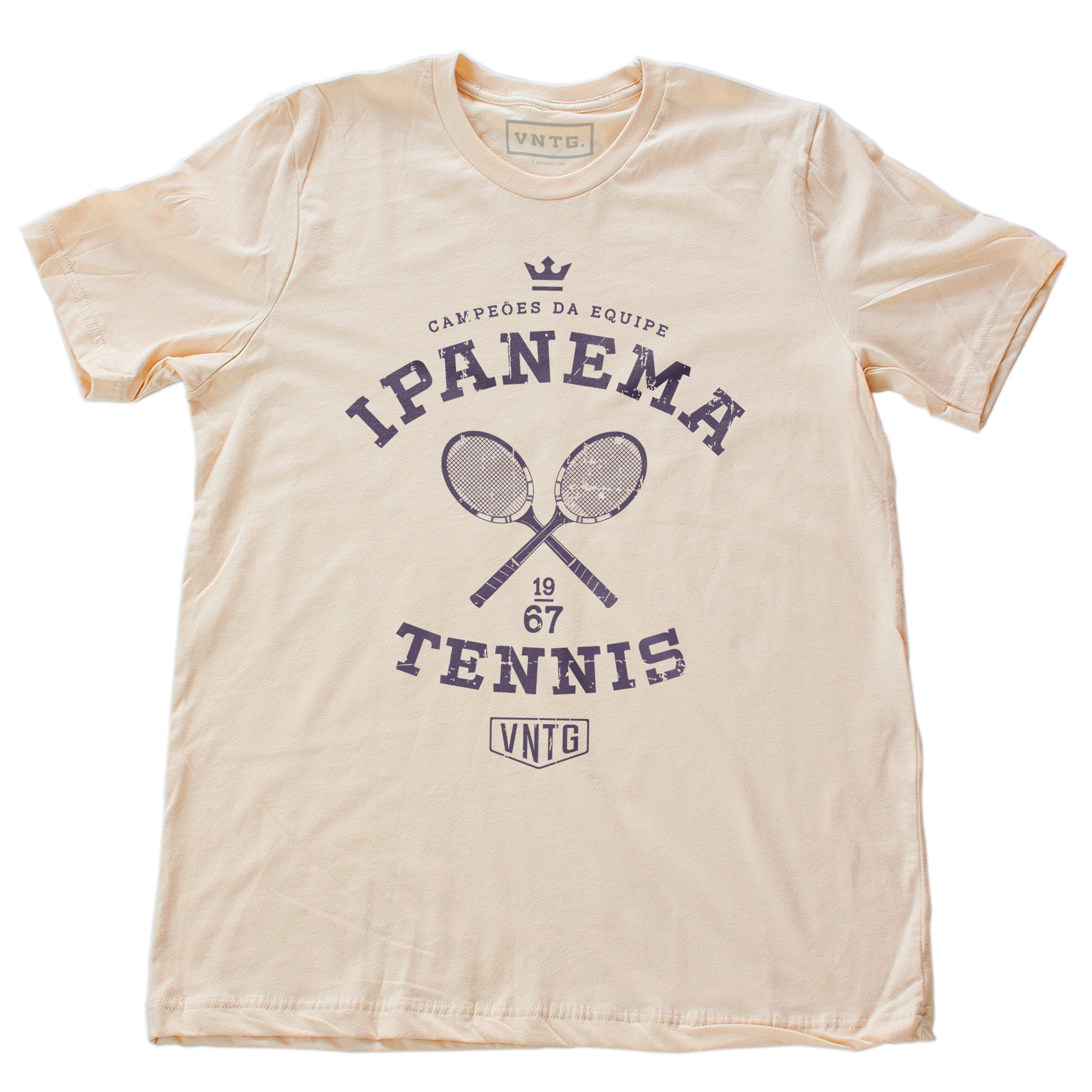 Vintage-inspired, retro graphic sports t-shirt in Soft Cream, as a 'team' shirt for a fictitious tennis team championship in Ipanema, Rio de Janeiro, Brazil. By fashion brand VNTG., from wolfsaint.net