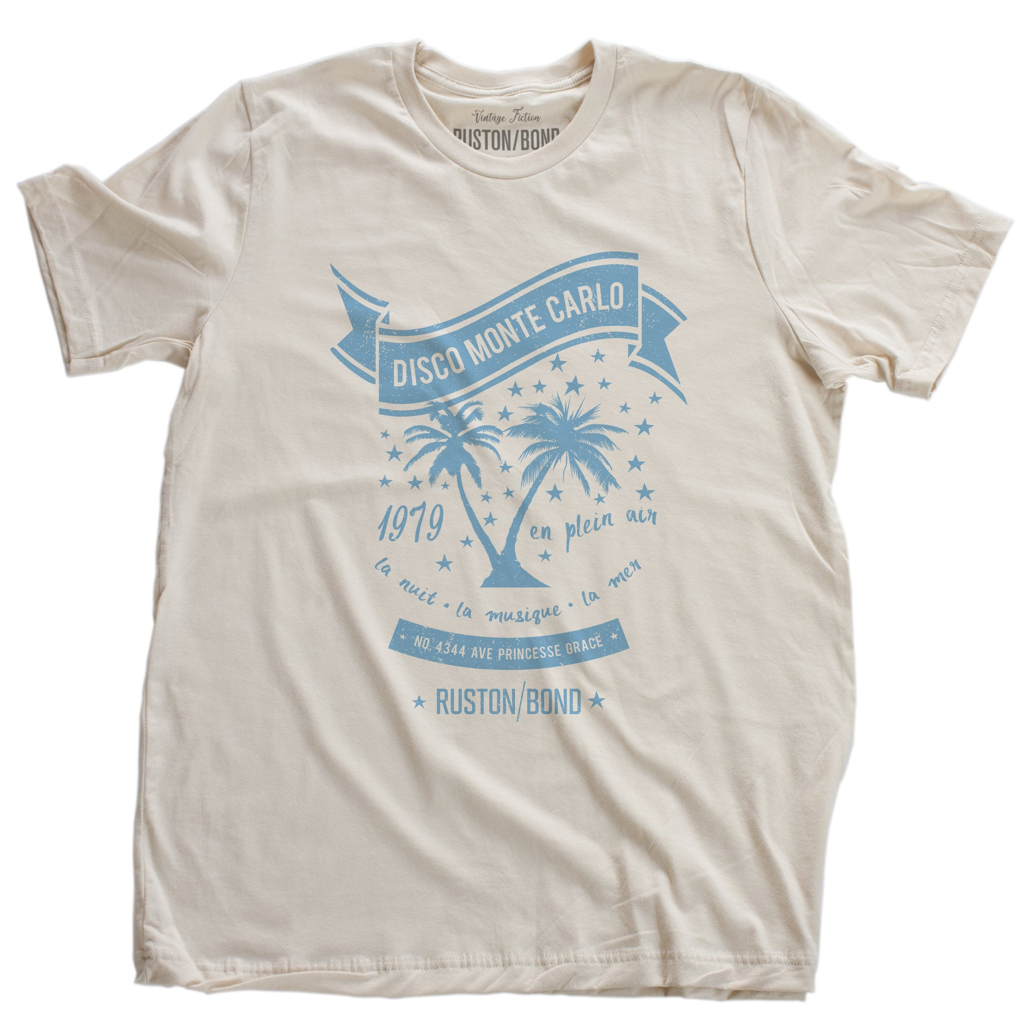 A retro, vintage-inspired t-shirt in Soft Cream, featuring palm trees against a starry sky, promoting a fictional Monte Carlo discotheque from the 1970s and 80s. By fashion brand Ruston/Bond, from wolfsaint.net