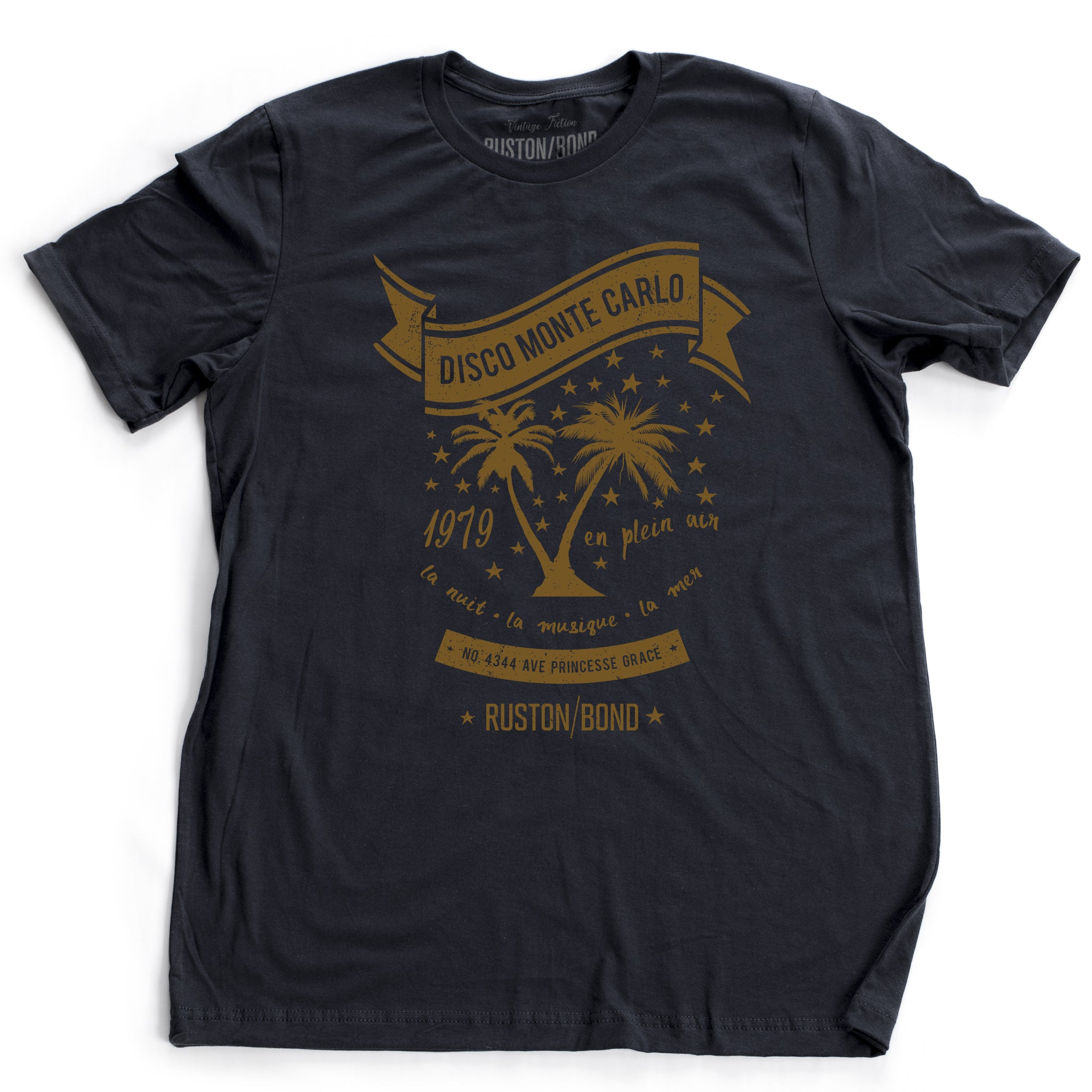 A retro, vintage-inspired t-shirt in navy blue, featuring palm trees against a starry sky, promoting a fictional Monte Carlo discotheque from the 1970s and 80s. By fashion brand Ruston/Bond, from wolfsaint.net