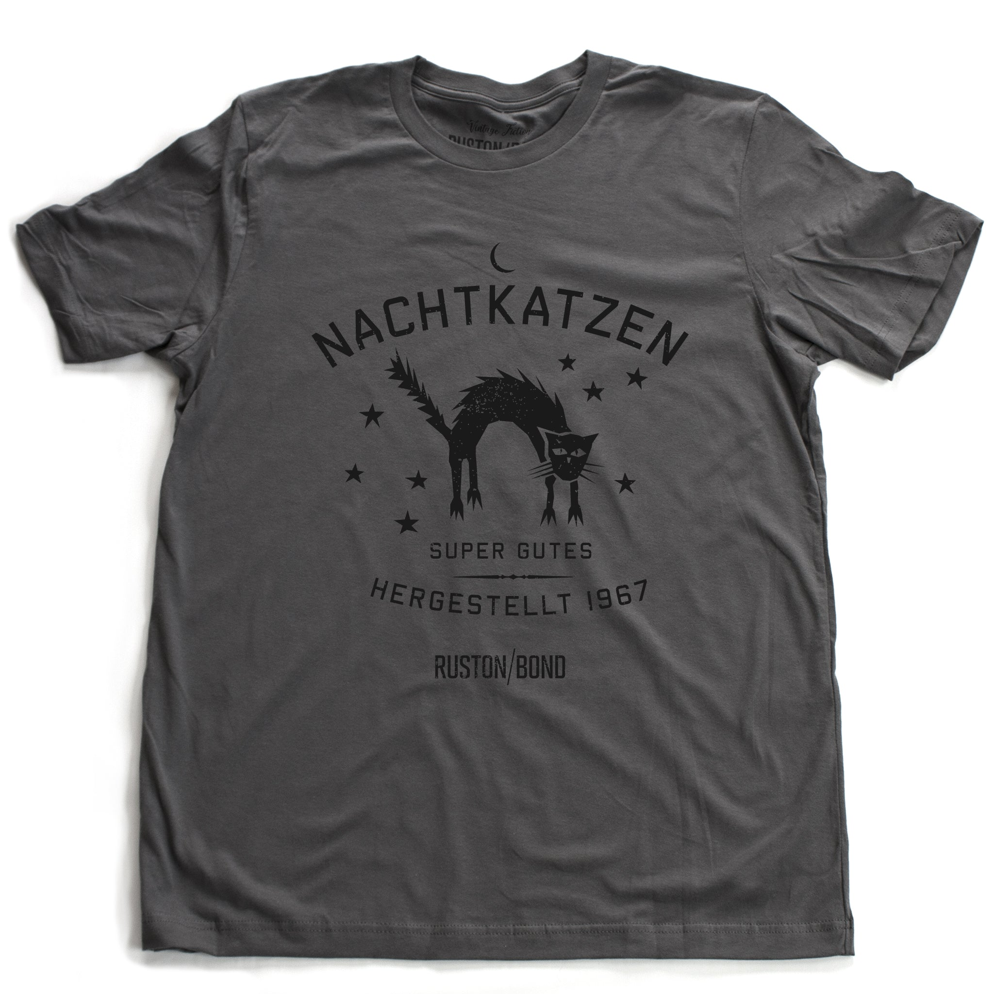 "A vintage-inspired retro design graphic t-shirt in Asphalt Gray, featuring the image of an arched cat among stars, and the German text ""NACHTKATZEN, Super Gutes"" — translating to ""Night Cats, super good"" and the year 1967, with the Ruston/Bond logo beneath. From wolfsaint.net"