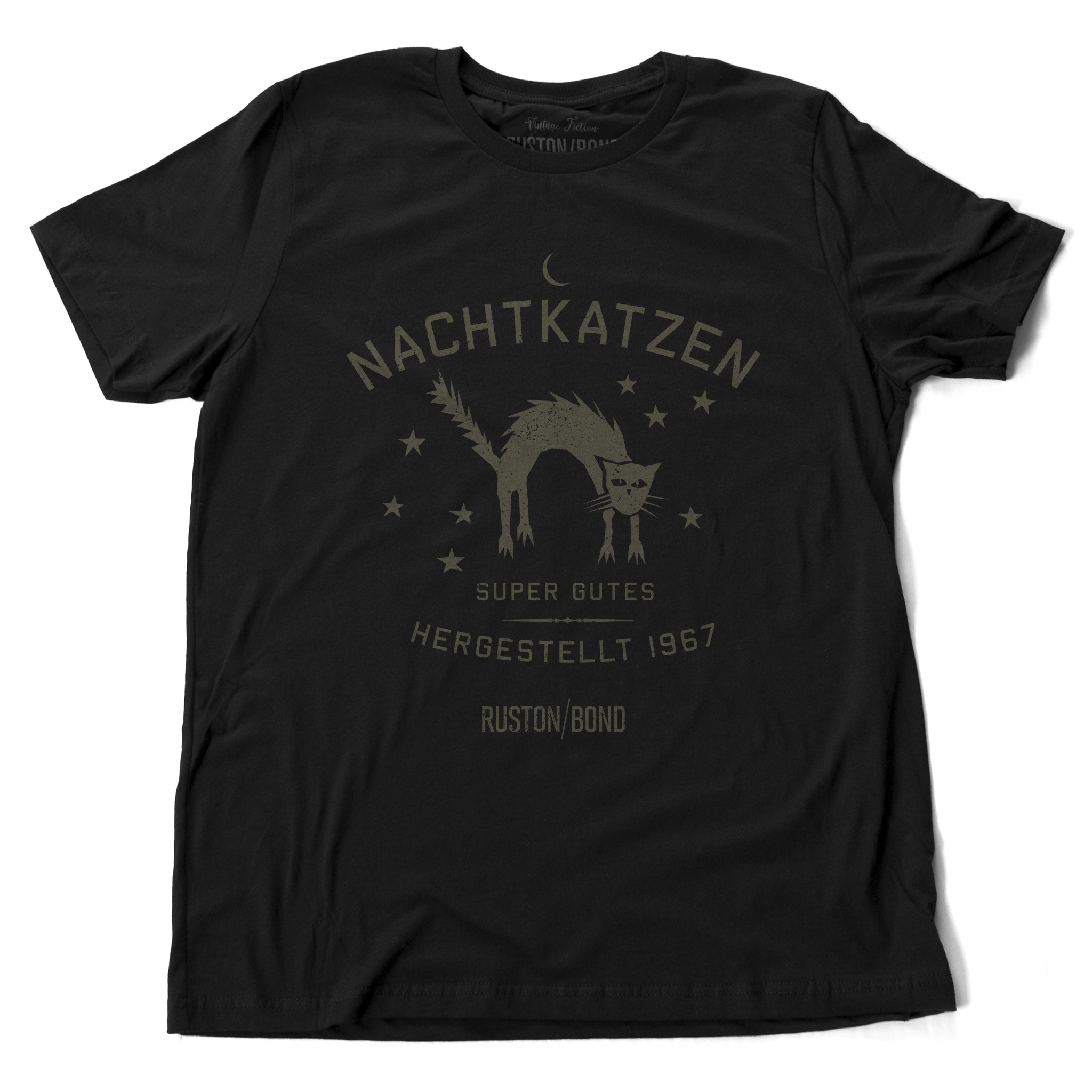 "A vintage-inspired retro design graphic t-shirt in classic Black, featuring the image of an arched cat among stars, and the German text ""NACHTKATZEN, Super Gutes"" — translating to ""Night Cats, super good"" and the year 1967, with the Ruston/Bond logo beneath. From wolfsaint.net"