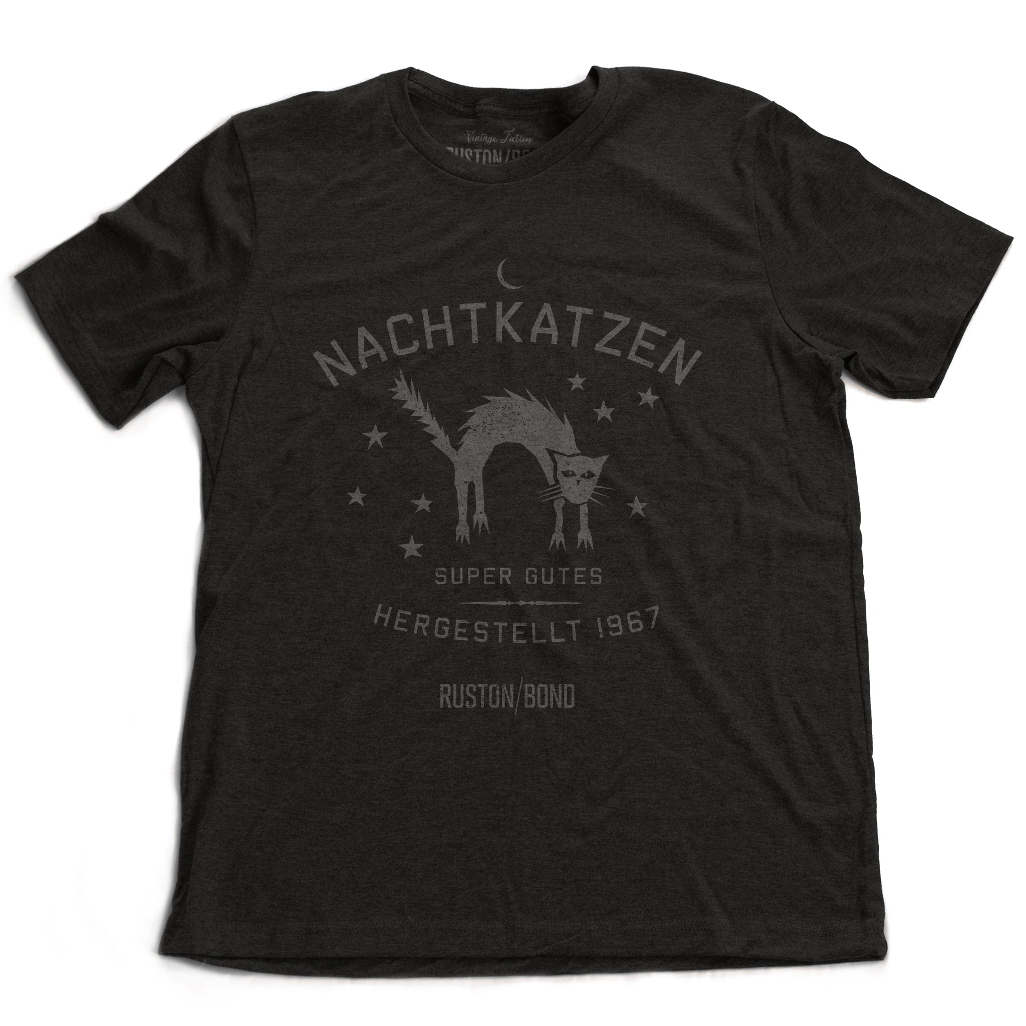 "A vintage-inspired retro design graphic t-shirt in Dark Gray Heather, featuring the image of an arched cat among stars, and the German text ""NACHTKATZEN, Super Gutes"" — translating to ""Night Cats, super good"" and the year 1967, with the Ruston/Bond logo beneath. From wolfsaint.net"
