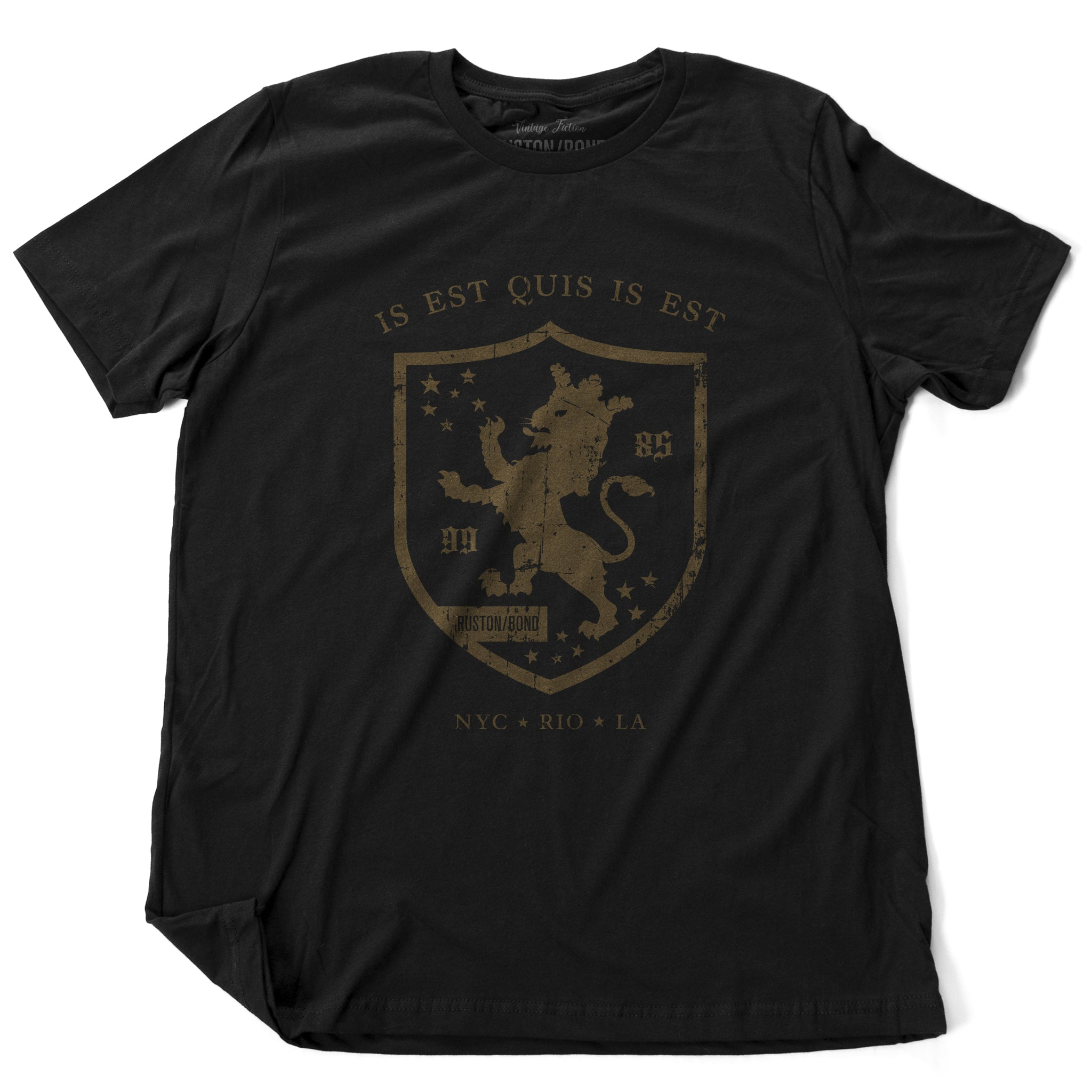 "A retro, vintage-inspired fashion t-shirt in Classic Black, with an medieval graphic of a lion within a shield,surrounded by the sarcastic text in Latin ""it is what it is,"" and New York, Rio, Los Angeles at the bottom. By fashion brand Ruston/Bond, from wolfsaint.net"