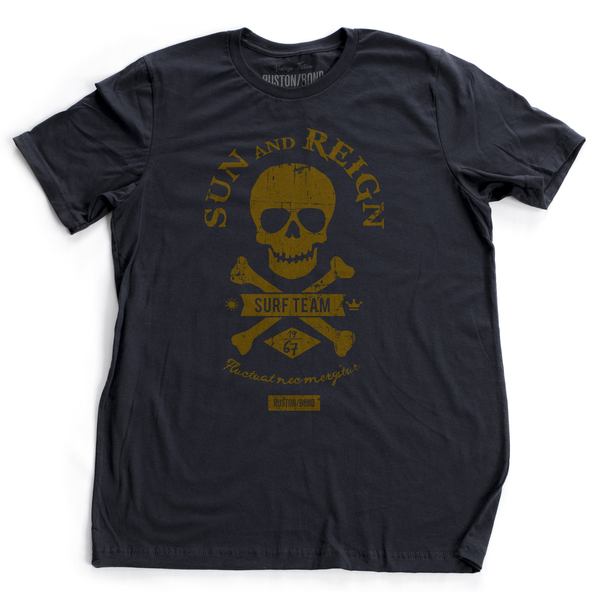 A fashionable, retro design t-shirt for a fictitious surf team. It features a skull and crossbones motif, surrounded by the typography SUN AND REIGN. By RUSTON/BOND, for wolfsaint.net