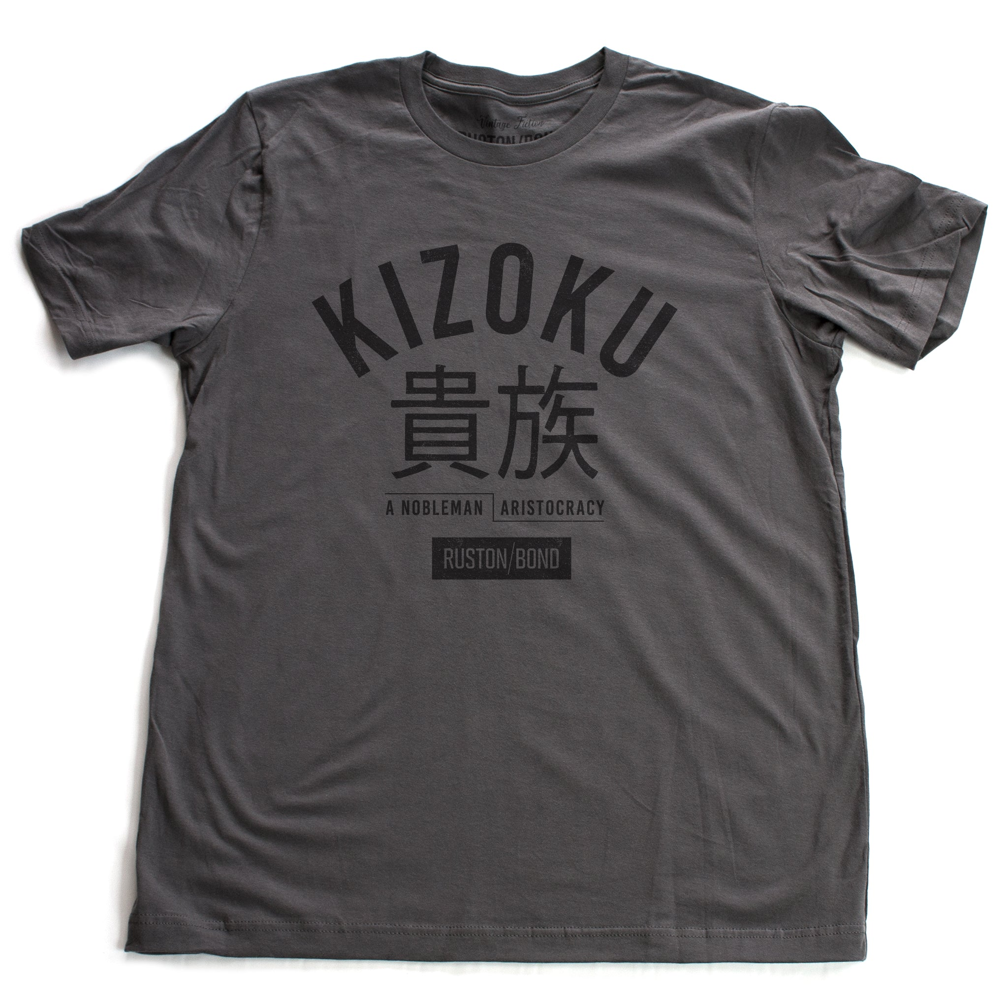 "A retro fashion t-shirt in Asphalt Gray with the bold typographic of the Japanese word ""KIZOKU"" and ""a nobleman / aristocracy"" below the Japanese characters. By the fashion brand Ruston/Bond, from wolfsaint.net."