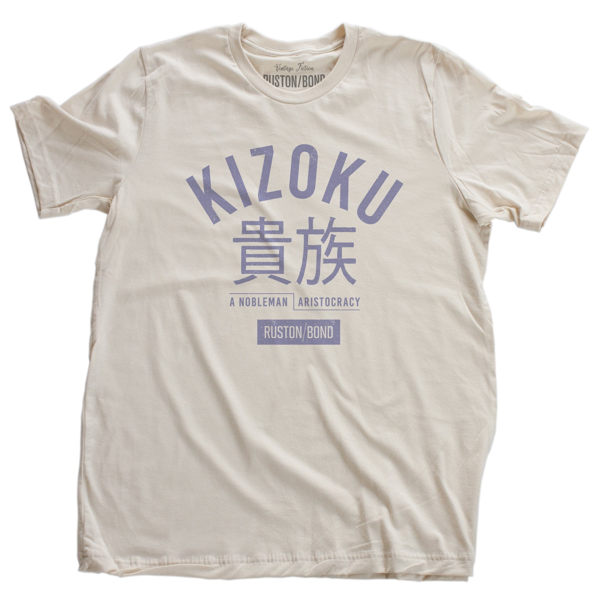 "A retro fashion t-shirt in Soft Cream with the bold typographic of the Japanese word ""KIZOKU"" and ""a nobleman / aristocracy"" below the Japanese characters. By the fashion brand Ruston/Bond, from wolfsaint.net."