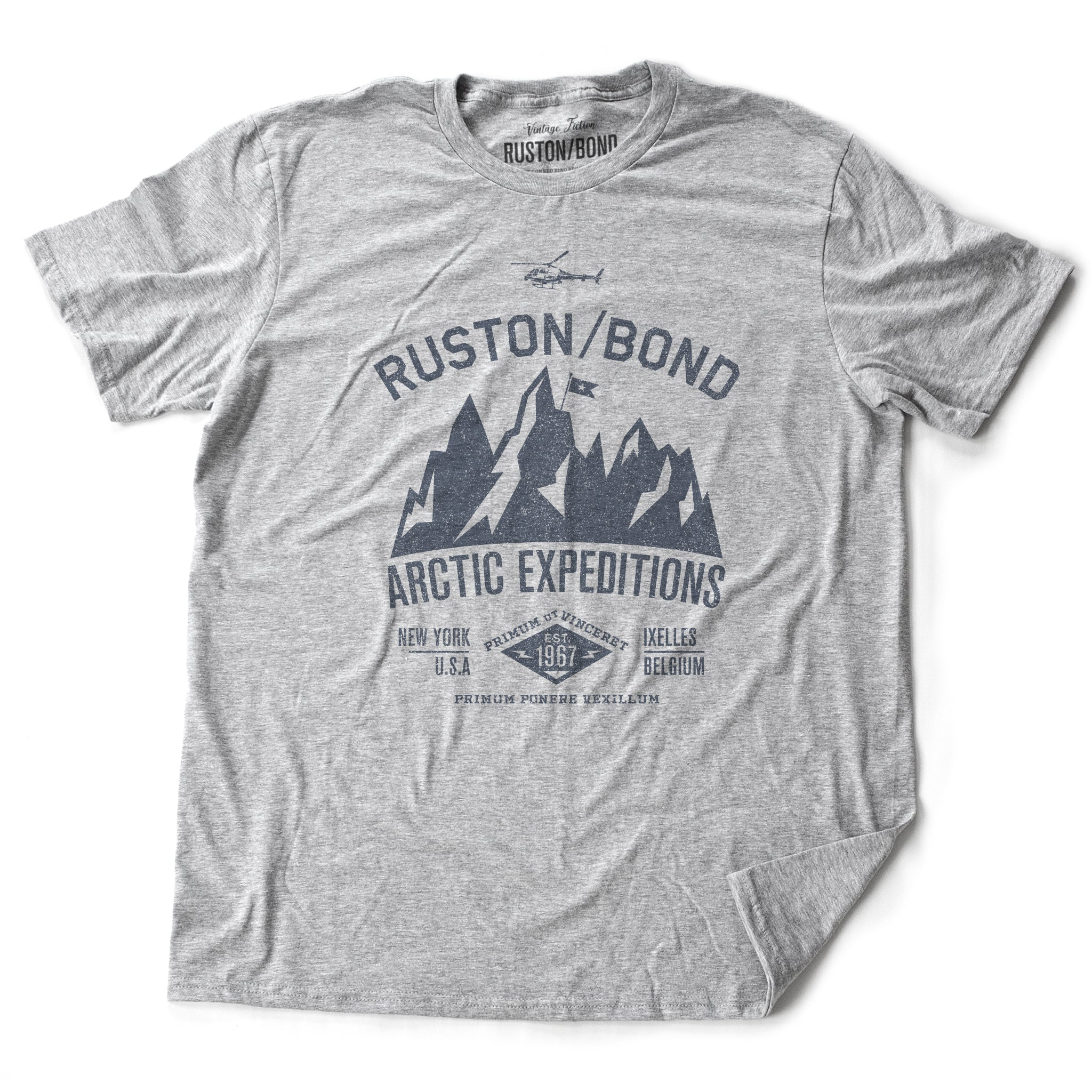 Athletic Gray / Grey  classic, fashion, retro inspired t-shirt, with a fictional advertisement for an adventure company called Ruston/Bond Arctic Expeditions. It shows a mountain range and a helicopter, and lists the company locations in New York City and Ixelles, Belgium, and a Latin quote.  Inspired by the films of Wes Anderson. From wolfsaint.net