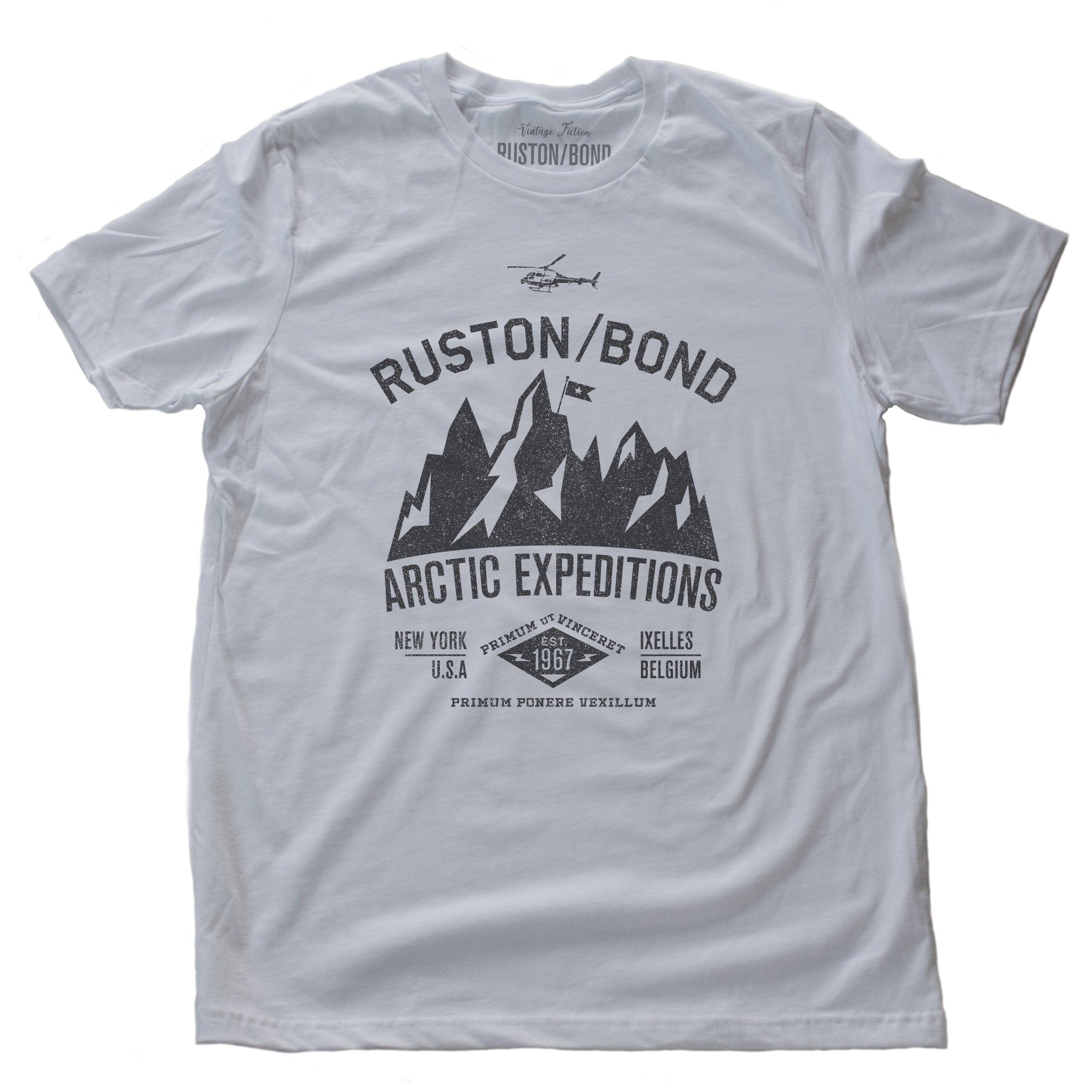 White  classic, fashion, retro inspired t-shirt, with a fictional advertisement for an adventure company called Ruston/Bond Arctic Expeditions. It shows a mountain range and a helicopter, and lists the company locations in New York City and Ixelles, Belgium, and a Latin quote.