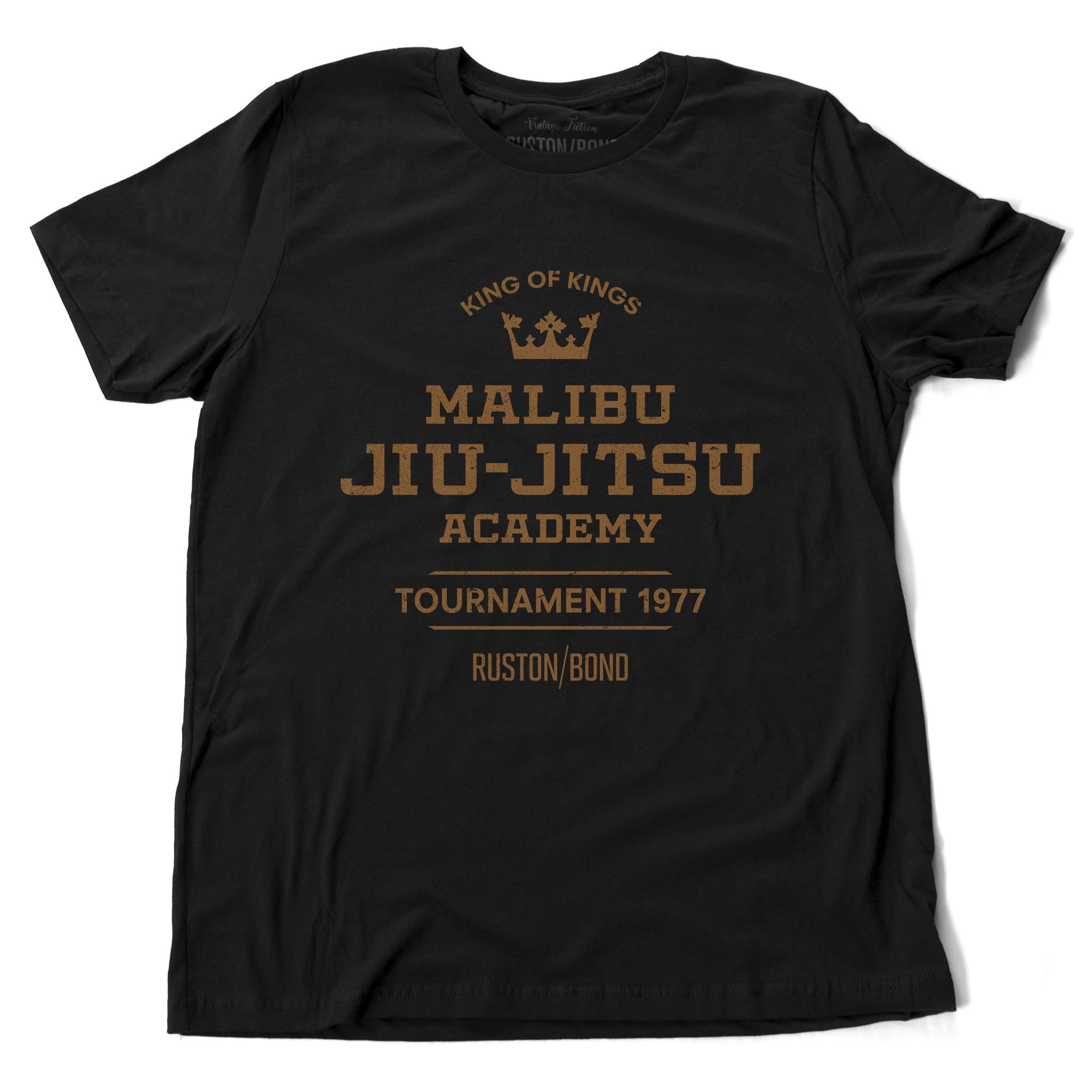 A fashionable, vintage-inspired retro t-shirt in Classic Black, featuring a graphic commemorating a sarcastic and fictitious Malibu (California) Jiu Jitsu academy and a 1977 tournament. By fashion brand Ruston/Bond, from wolfsaint.net