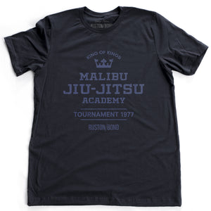 A fashionable, vintage-inspired retro t-shirt in classic Navy Blue, featuring a graphic commemorating a sarcastic and fictitious Malibu (California) Jiu Jitsu academy and a 1977 tournament. By fashion brand Ruston/Bond, from wolfsaint.net