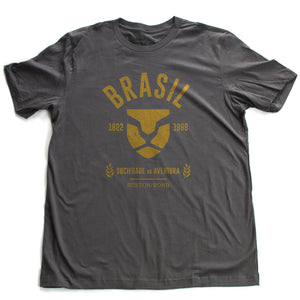 Asphalt gray fashion, retro-inspired t-shirt featuring classic graphic of a strong, minimalist Lion head, for a fictional adventure society in Brazil / Brasil from 1822 to 1888, by the brand Ruston/Bond. From wolfsaint.net