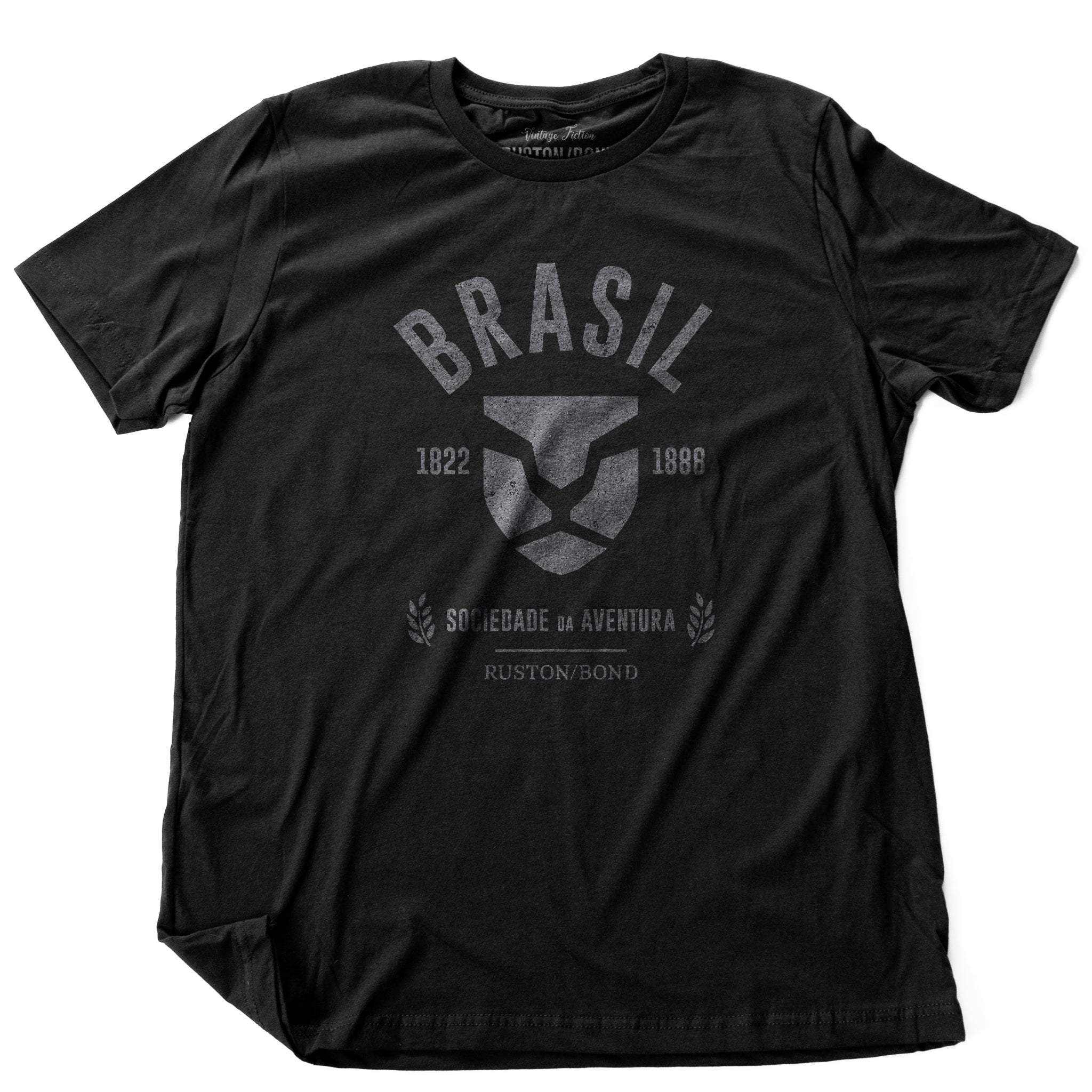 Black fashion, retro-inspired t-shirt featuring classic graphic of a strong, minimalist Lion head, for a fictional adventure society in Brazil / Brasil from 1822 to 1888, by the brand Ruston/Bond. From wolfsaint.net