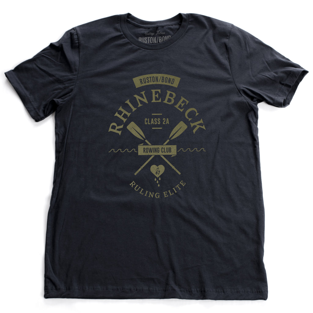 "A preppy, vintage-look, retro graphic t-shirt, for a fictional Rhinebeck (New York) rowing club. It depicts two oars over waves, and the celebratory words ""ruling elite"" below a heart. In classic Navy Blue, by fashion brand Ruston/Bond, for a wolfsaint.net"