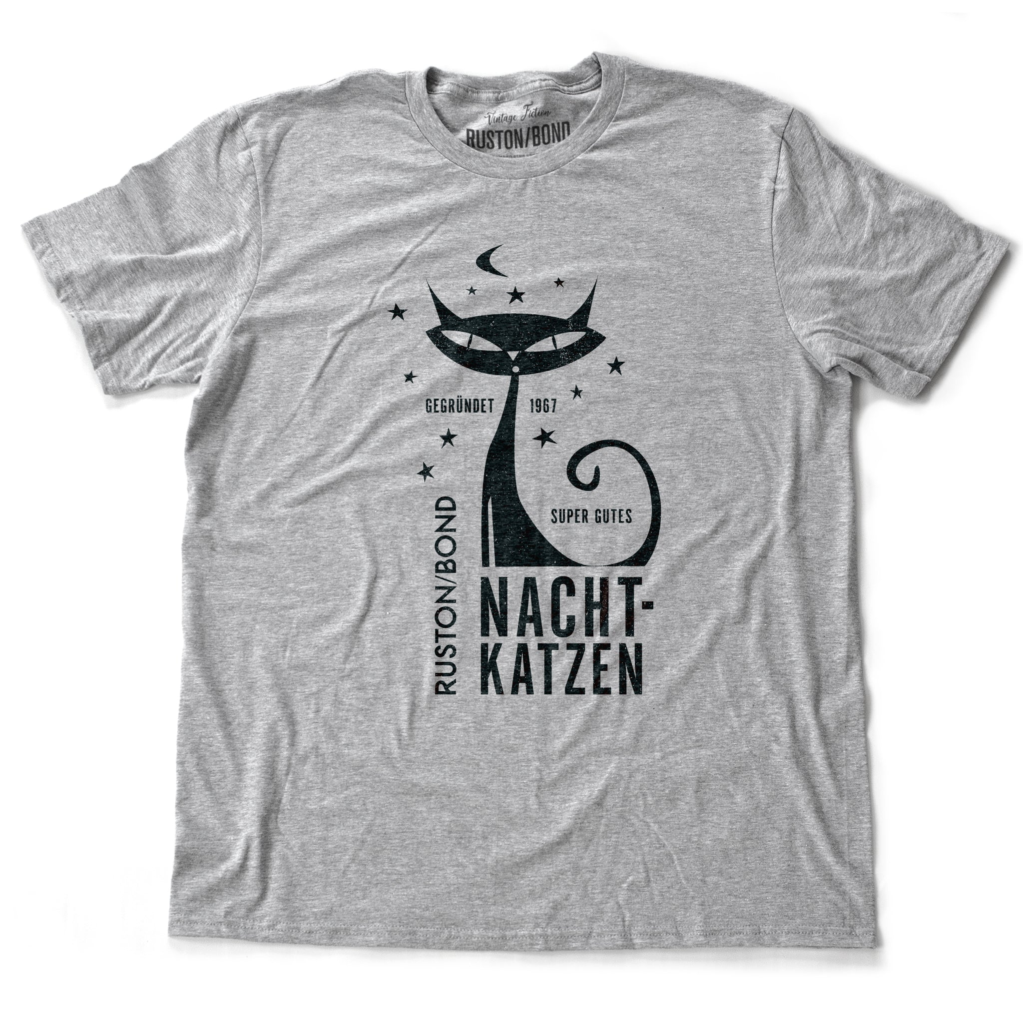 "A vintage-inspired retro design t-shirt in classic Heather Gray, featuring the image of a stylized cat graphic among stars, and the German text ""NACHTKATZEN, Super Gutes"" — translating to ""Night Cats, super good"" and the year 1967, with the Ruston/Bond logo beneath. From wolfsaint.net"