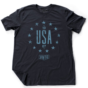 "A vintage inspired, classic, retro design, graphic t-shirt with ""USA"" in large letters, surrounded by 13 stars of the original American colonies, and the VNTG. logo beneath. From wolfsaint.net"