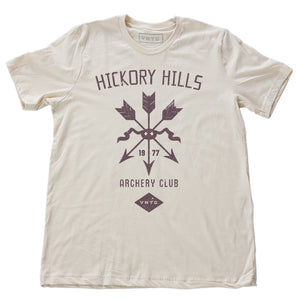 A vintage-inspired retro t-shirt in Soft Cream, featuring a graphic of a quiver of arrows, representing a small town amateur archery club from 1977.  By fashion brand VNTG, from wolfsaint.net