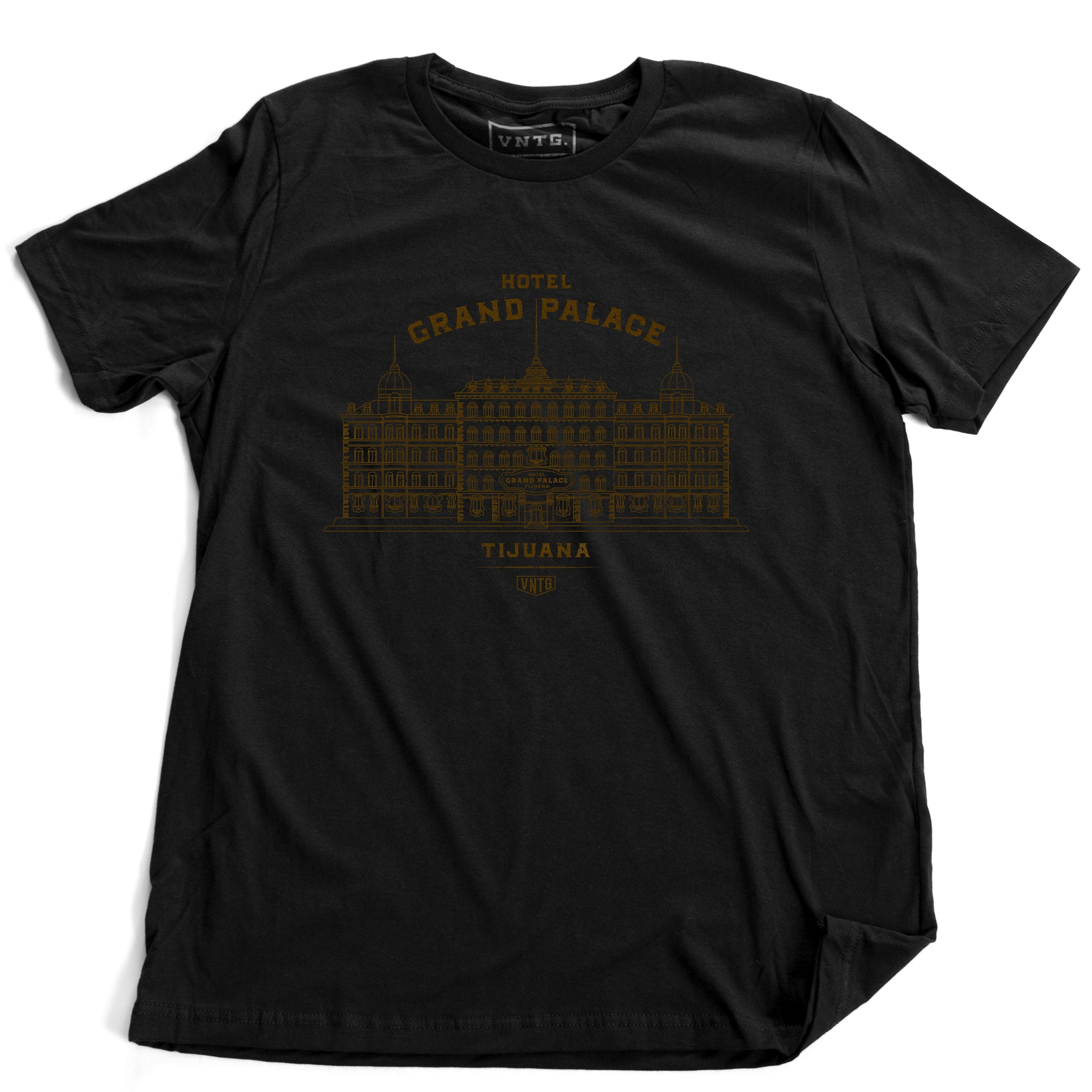 A vintage-inspired retro t-shirt in black, promoting a fictional, sarcastic grand hotel in Tijuana, Mexico. From fashion brand VNTG, from wolfsaint.net The shirt depicts an elegant old hotel in an intricate line drawing. Inspired by the films of Wes Anderson, including The Grand Budapest Hotel.
