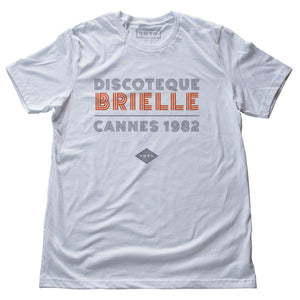 "A fashionable classic white graphic tee, for a fictional Cannes, France disco from 1982. The retro typography reads ""DISCOTEQUE BRIELLE / CANNES 1982"" with the VNTG. diamond logo beneath. From Wolfsaint.net"