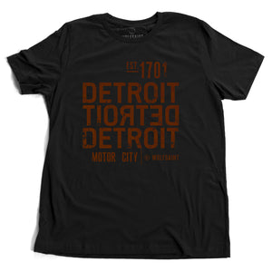 A strong graphic retro black t-shirt with the word DETROIT — motor city — in bold typography, forward and backward, from Wolfsaint.net