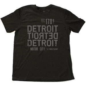 A strong graphic retro dark gray heather t-shirt with the word DETROIT — motor city — in bold typography, forward and backward, from Wolfsaint.net