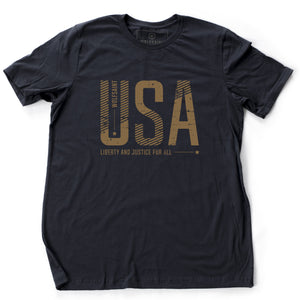 "A bold graphic t-shirt featuring large custom-designed font reading ""USA"" and ""liberty and justice for all"" below. From wolfsaint.net"