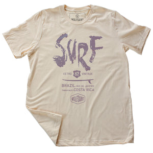 "A fashionable graphic t-shirt with a retro, vintage design. This shirt features a surfboard graphic beneath large painted type which reads ""SURF"" and below it ""Brazil, Rio de Janeiro, and Tamarindo, Costa Rica"" above the Wolfsaint logo.  For wolfsaint.net"