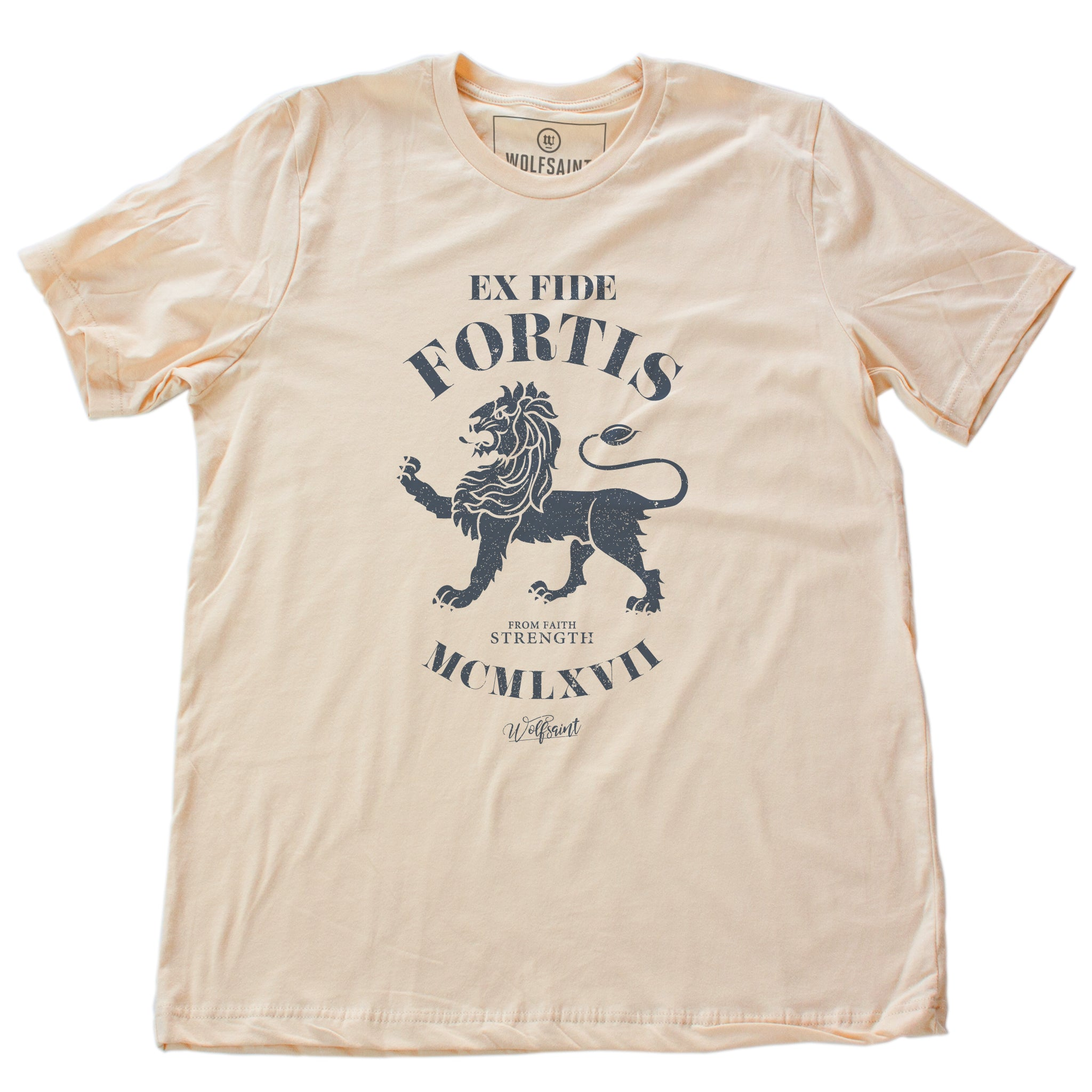 "A vintage-inspired classic Soft Cream retro t-shirt featuring a strong graphic of a lion, with the Latin phrase meaning ""Out of faith, strength."" By wolfsaint.net"
