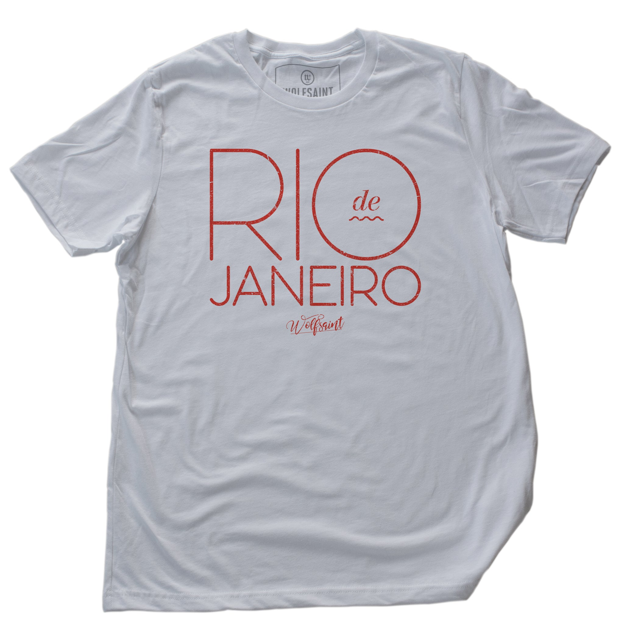 An elegant, retro design fashion t-shirt with RIO DE JANEIRO in large orange typography in a thin font on White cotton. The Wolfsaint script logo is below. From Wolfsaint.net