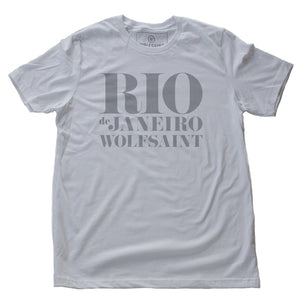 "A retro graphic t-shirt in classic White, with ""RIO"" large, above ""de Janeiro"" and ""Wolfsaint"" in a bold, fashion-forward font. From Wolfsaint.net"
