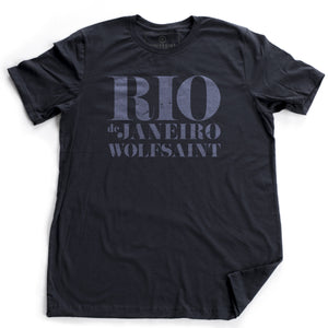 "A retro graphic t-shirt in classic Navy Blue, with ""RIO"" large, above ""de Janeiro"" and ""Wolfsaint"" in a bold, fashion-forward font. From Wolfsaint.net"