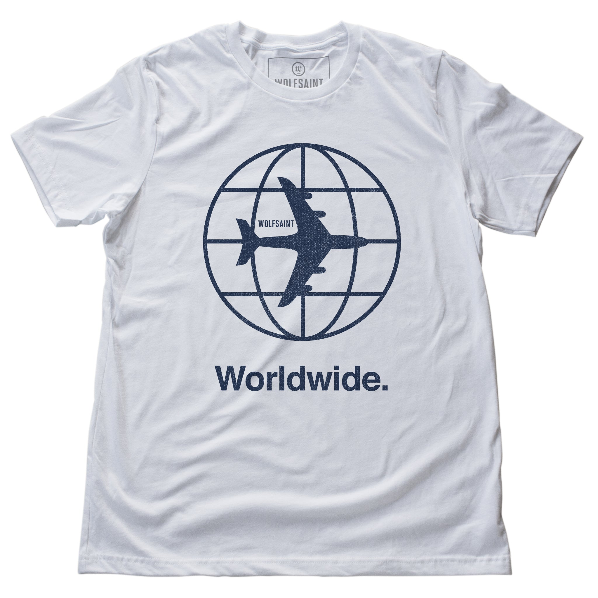 "The front of the white version of a fashion t-shirt representing a jetsetting lifestyle. On the front of the shirts is a simple graphic of a commercial airliner superimposed on a globe, and the word ""Worldwide."" On the reverse is a stack of airport codes representing international travel (New York/JFK, Los Angeles/LAX; Rio de Janeiro/GIG; San Jose Costa Rica/SJO; Tokyo/NRT; Paris/CDG). By fashion brand WOLFSAINT, from wolfsaint.net"