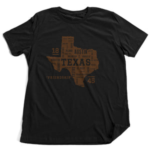 "A stylish graphic t-shirt featuring the form of the state of Texas, with the various most populous Texan cities arranged as a collage within the state shape. It also commemorates the year 1845 and state motto ""friendship."" By Wolfsaint.net"