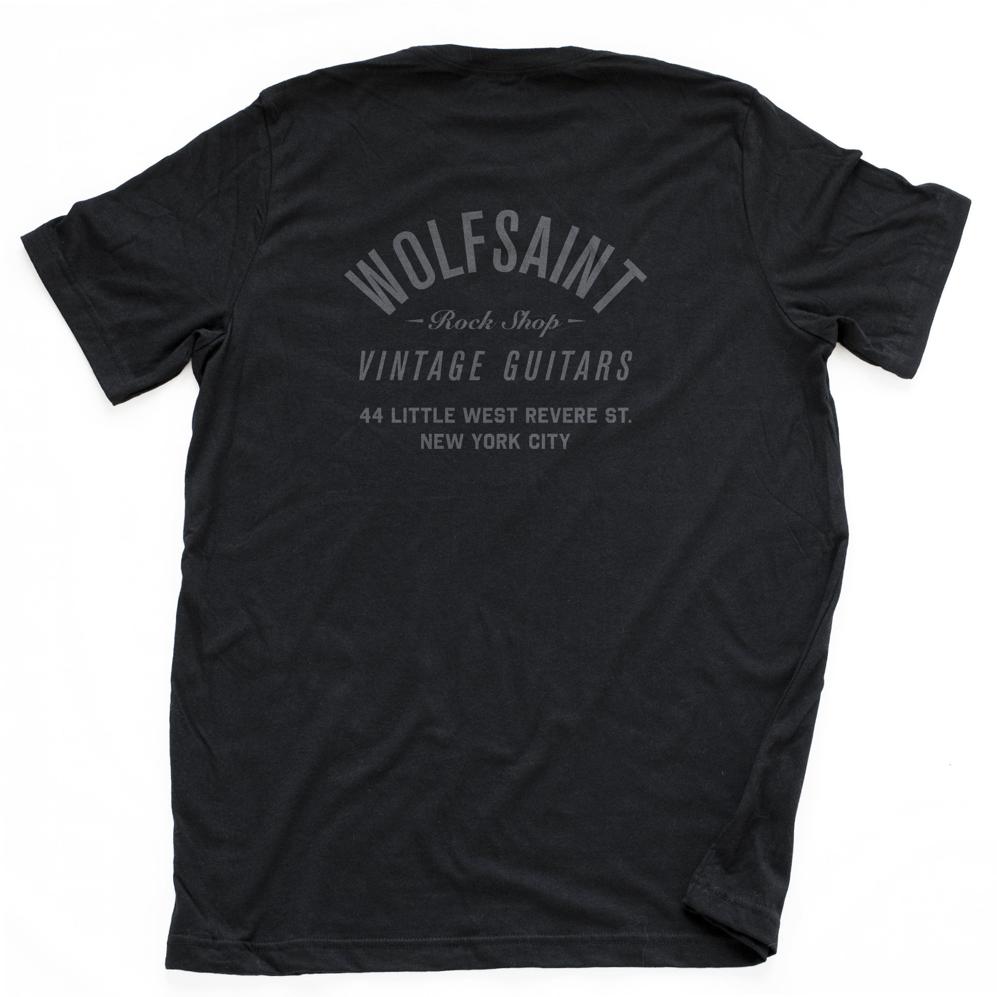 A retro design, vintage-inspired t-shirt for a fictional vintage guitars shop. Featuring a graphic on the front of a Gibson Es-335 guitar and the Wolfsaint script logo, and an imaginary address on the back. From Wolfsaint.net