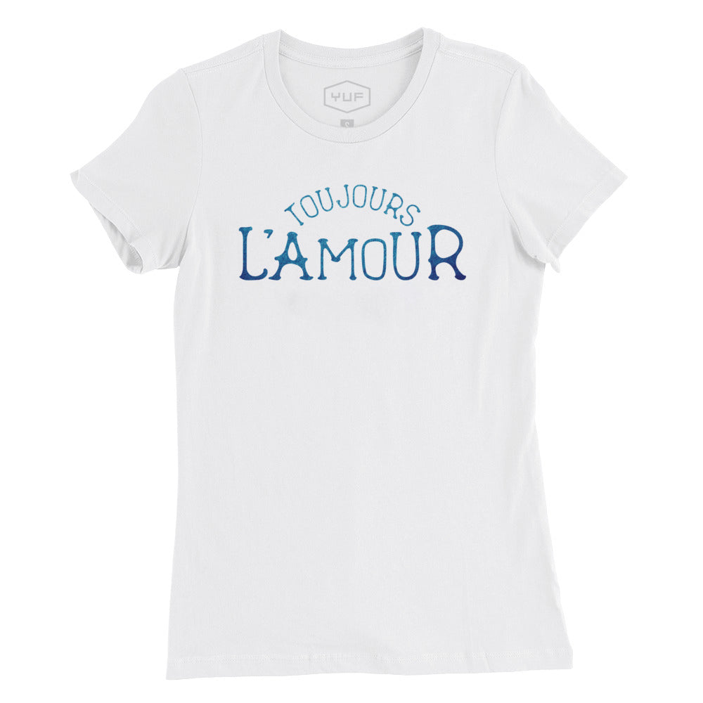 "A women's cut fashion t-shirt in Classic White with the retro, vintage-inspired typographic statement ""TOUJOURS L'AMOUR,"" French for ""love always."" By fashion brand YUF, from Wolfsaint.net"