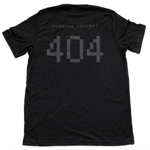 "A graphic t-shirt with a sarcastic meme theme, showing the digital ""404 missing content"" error message common to internet searches. From Wolfsaint.net"