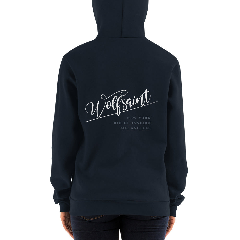 "A trendy hoodie sweatshirt in Blue, with the elegant Wolfsaint script logo in white, and the Wolfsaint cities listed below: ""New York, Rio de Janeiro, Los Angeles"". From Wolfsaint.net"