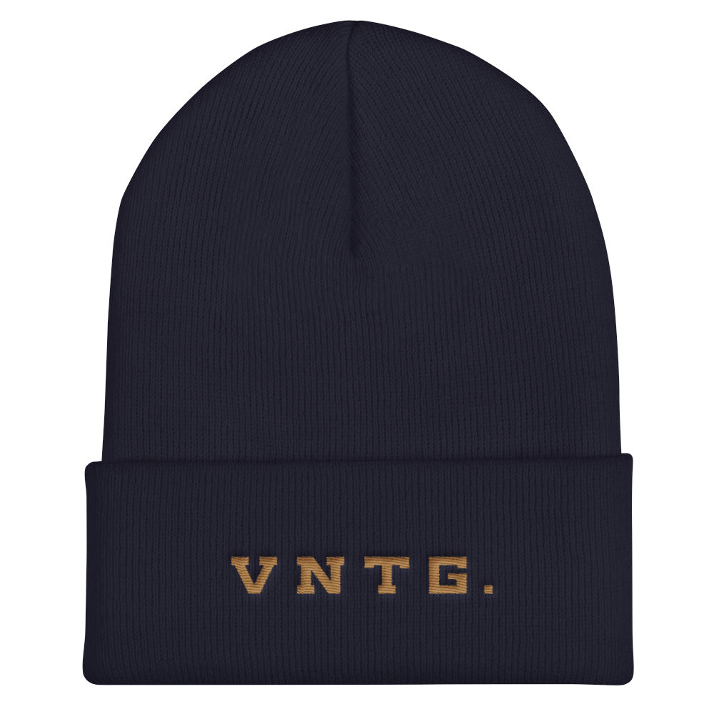 A stylish knit cap or beanie in classic Navy Blue, with the brand logo VNTG. embroidered in gold thread. From wolfsaint.net