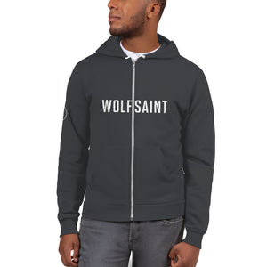 "A male model in a white studio wearing a fashionable, trendy Gray zippered hoodie sweatshirt with the WOLFSAINT gothic logo in white across the chest and the ""W"" circle crest on the right sleeve. From fashion brand wolfsaint.net"