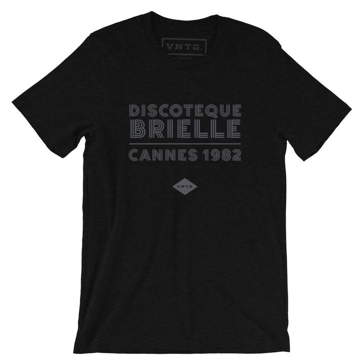 "A fashionable classic black graphic tee, for a fictional Cannes, France disco from 1982. The retro typography reads ""DISCOTEQUE BRIELLE / CANNES 1982"" with the VNTG. diamond logo beneath. From Wolfsaint.net"